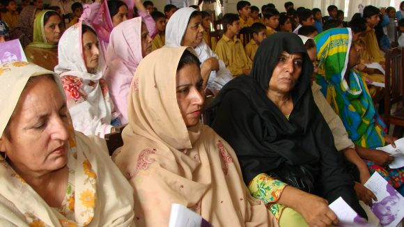 Representatives, teachers, and children attend a seminar on World Sight Day in Pakistan.
