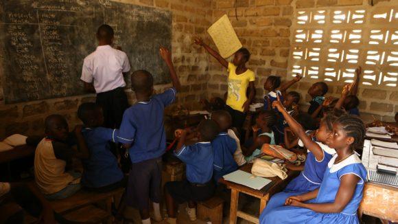 Children undergo inclusive schooling in a classroom in Sierra Leone.