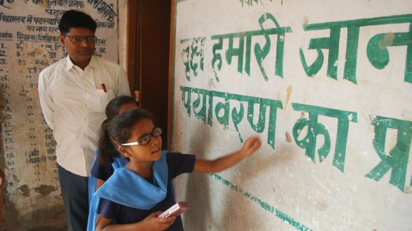 A child with a visual impairment learns in a school in India.