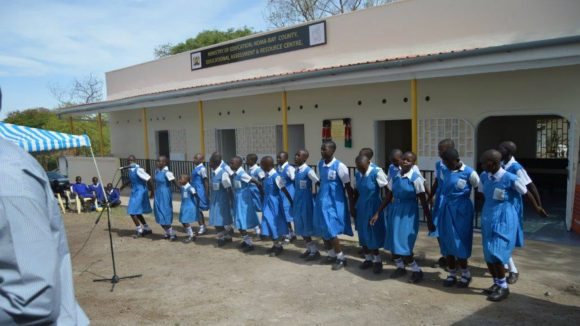 Children line up at an educational assessment centre in Kenya.