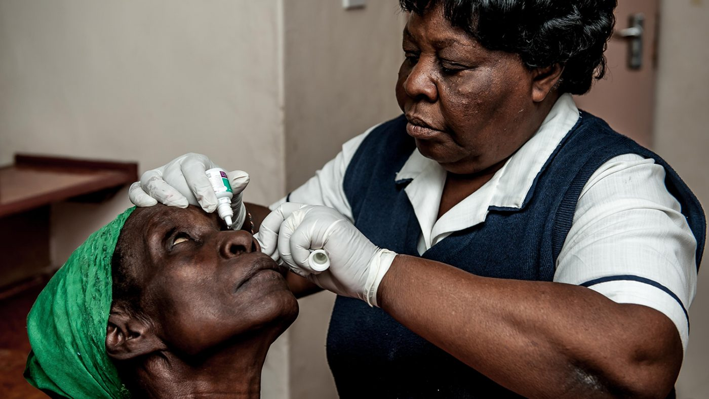 Nazondani Mologeni having eye drops administered.