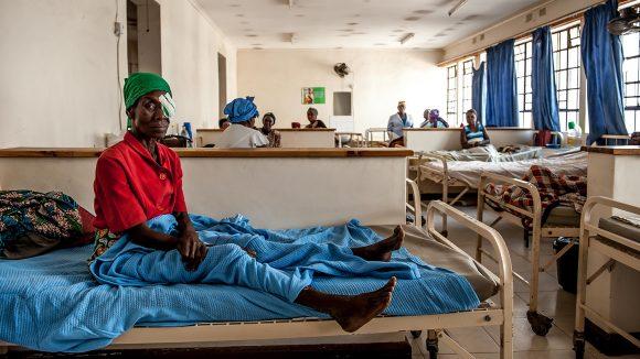 Nazondani Mologeni, 76, sitting on her bed in hopsital.