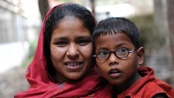 A mother with her son in Dhaka. He is wearing his new spectacles.