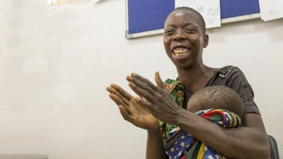 Laurinda laughing and clapping after cataract surgery.