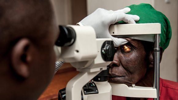 Nazondani Mologeni, 76, having her eyes checked by OCO Harold Malinda.