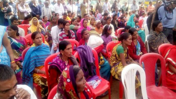 People in Bhopal, India attend a busy eye screening meeting.