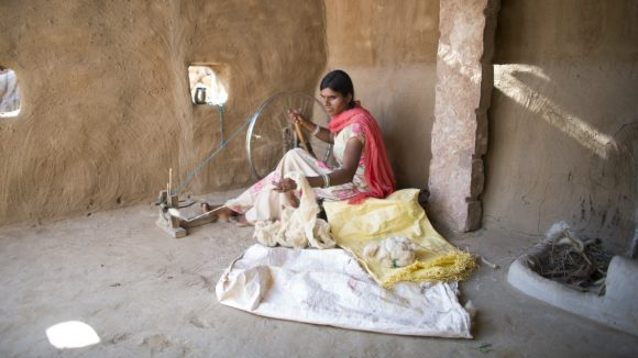 Bhanvari, who is blind, weaves in her home in the Bikaner district of India.