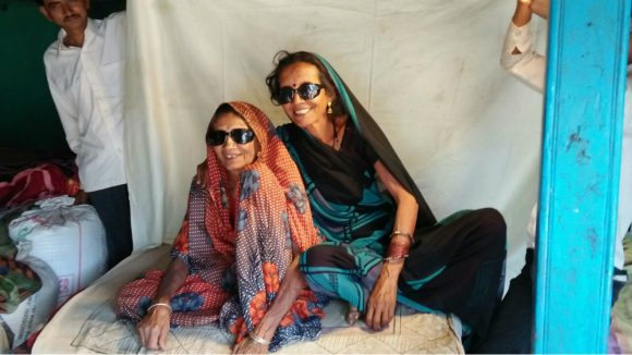 A mother and daughter hug after receiving cataract operations in India.