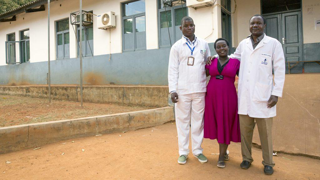 Dr Anselmo with eye technician Domingos Geraldo and Signtsavers' Christina Abudo outside Ribaue Hospital.