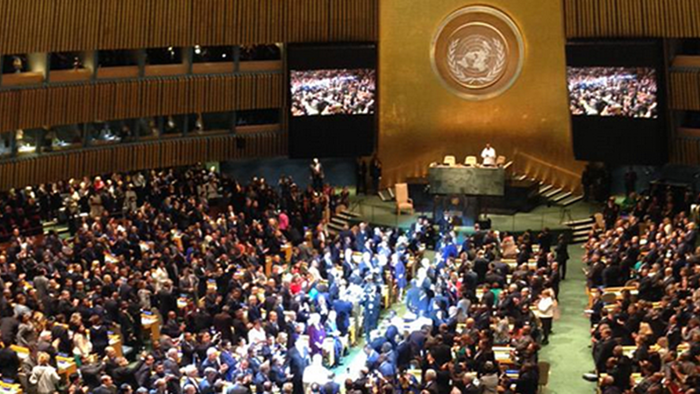 An image of hundreds of people sat in a room at the UN.