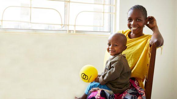 Baraka plays with a yellow balloon.