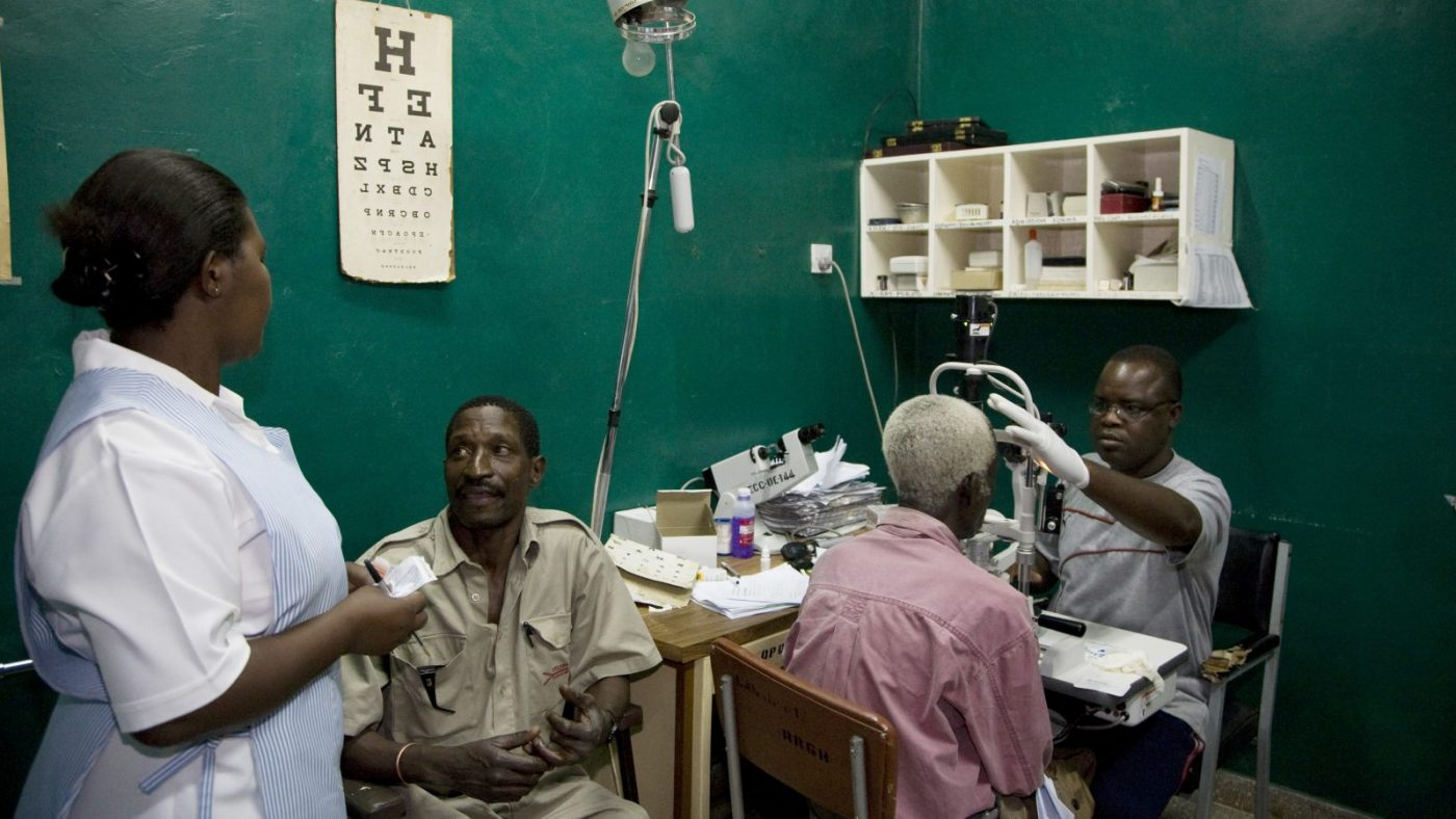 Eye examinations taking place in an office.
