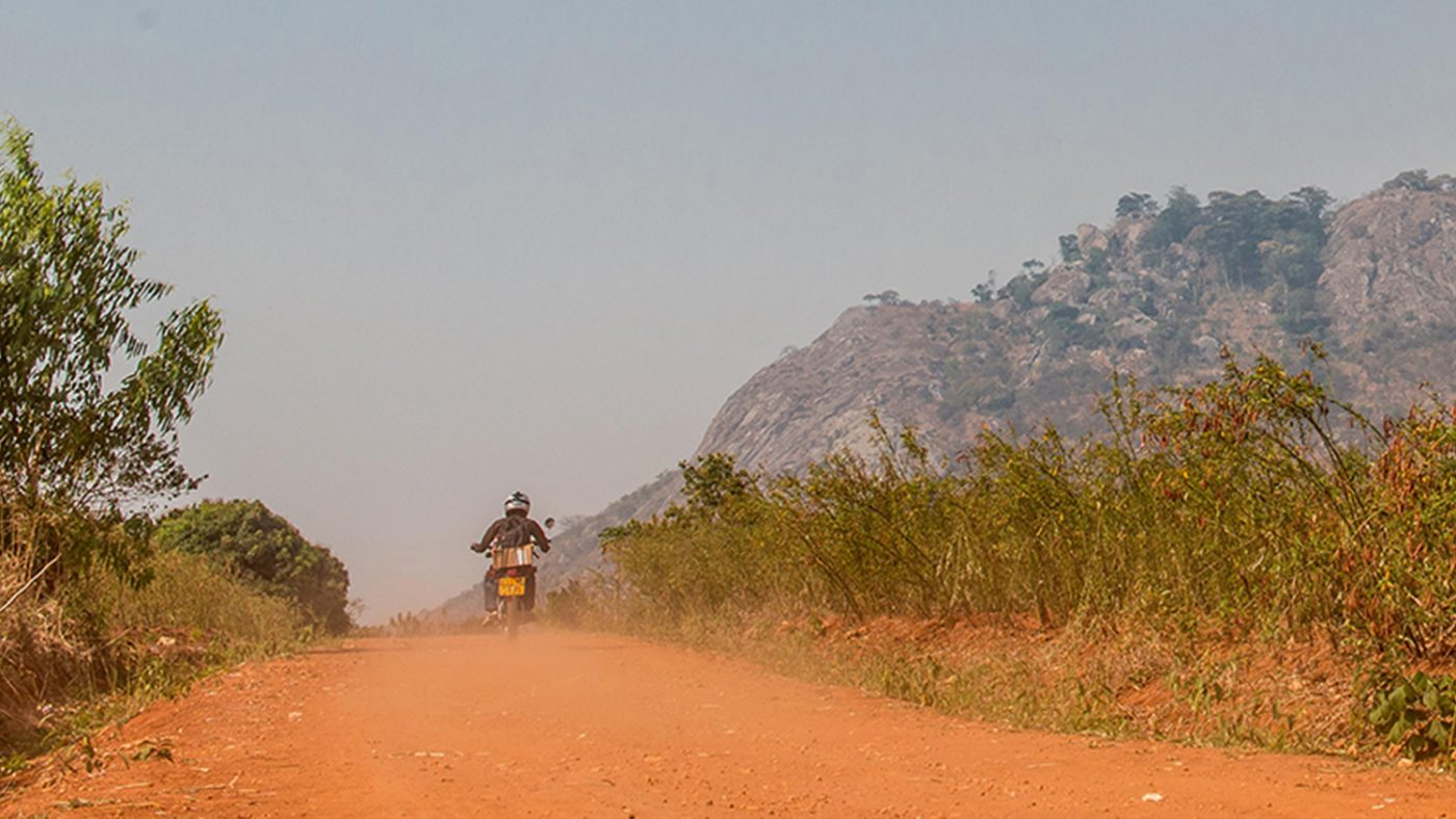 A mountainous landscape in Malawi with a solo motorbike.