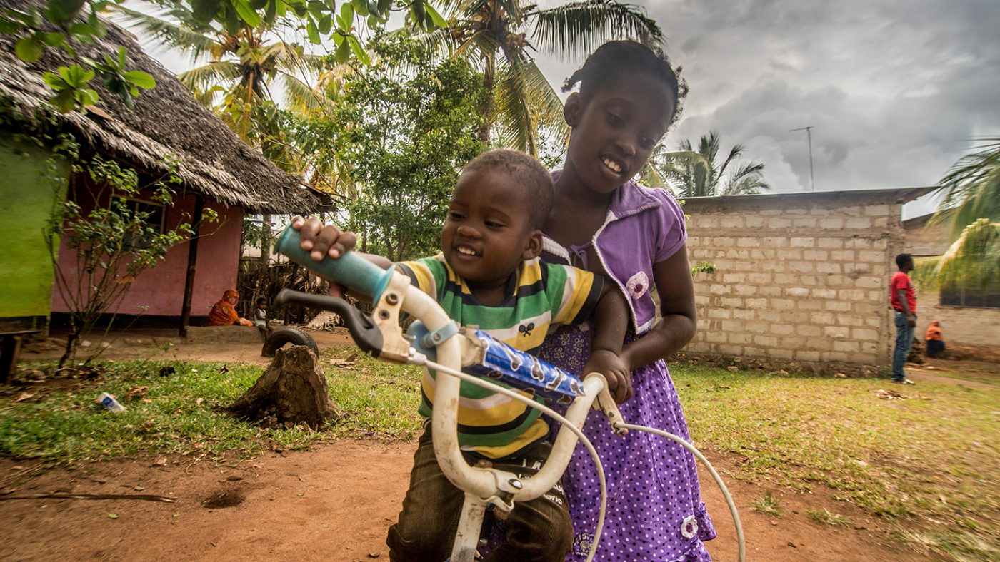 Two year old Bakir Rashid, who suffers from congenital cataracts, plays with his sister Barke in the village of ——, Zanzibar, a week before undergoing a sight restoring operation supported by Sightsavers.