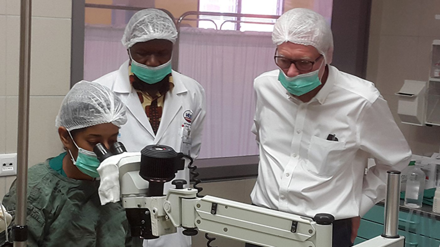Sightsavers Board of Trustees chairman Martin Dinham watches a cataract operation in Mozambique.