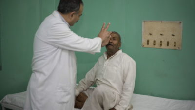 A patient has his eyes examined by an eye specialist.