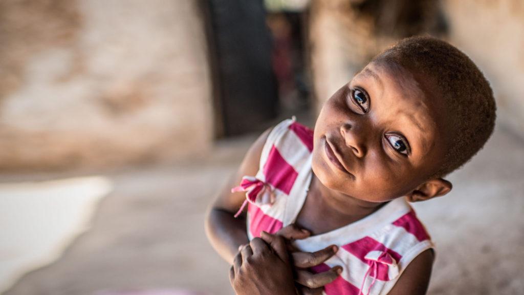 Asha Abubakar outside her home in Tanzania following her successful cataract operation.