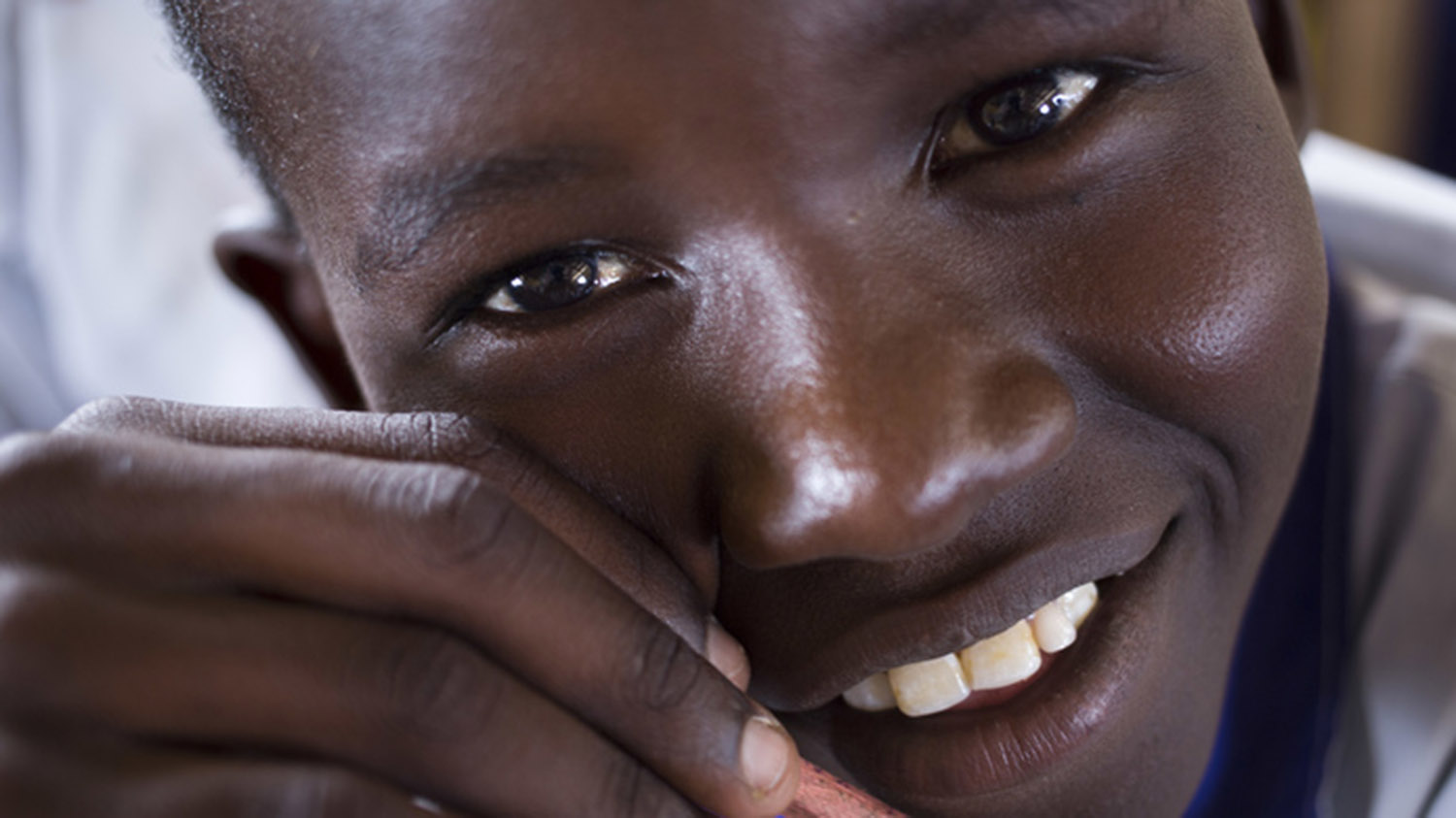 A close up photo of Leonard Kalokol, a 13 years old school boy whose class has lessons in facewashing to help eliminate the blinding eye disease trachoma in Kenya.