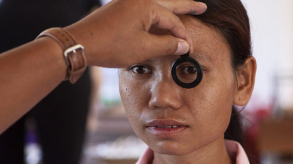 A woman has her eyes tested.