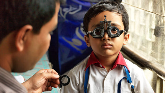 A young boy in Bangladesh having his eyes tested.