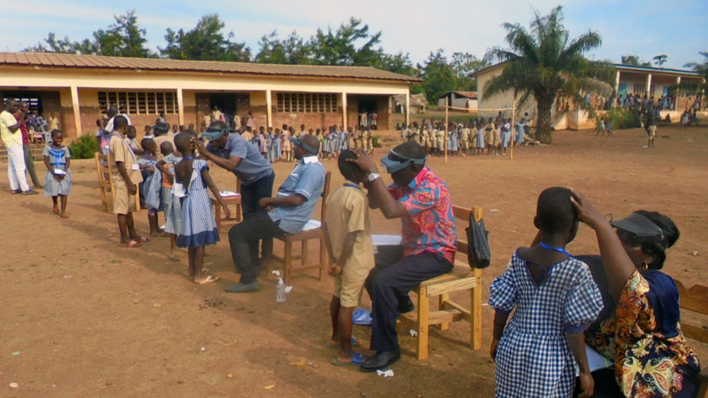 A chldren que to be examined be health workers in Cote d'Ivoire.