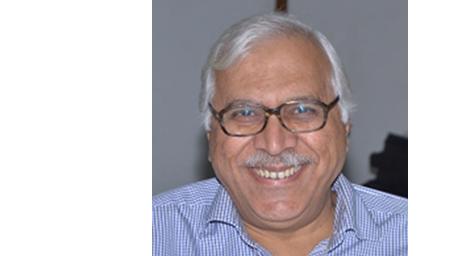 A portrait of Dr Quraishi.
