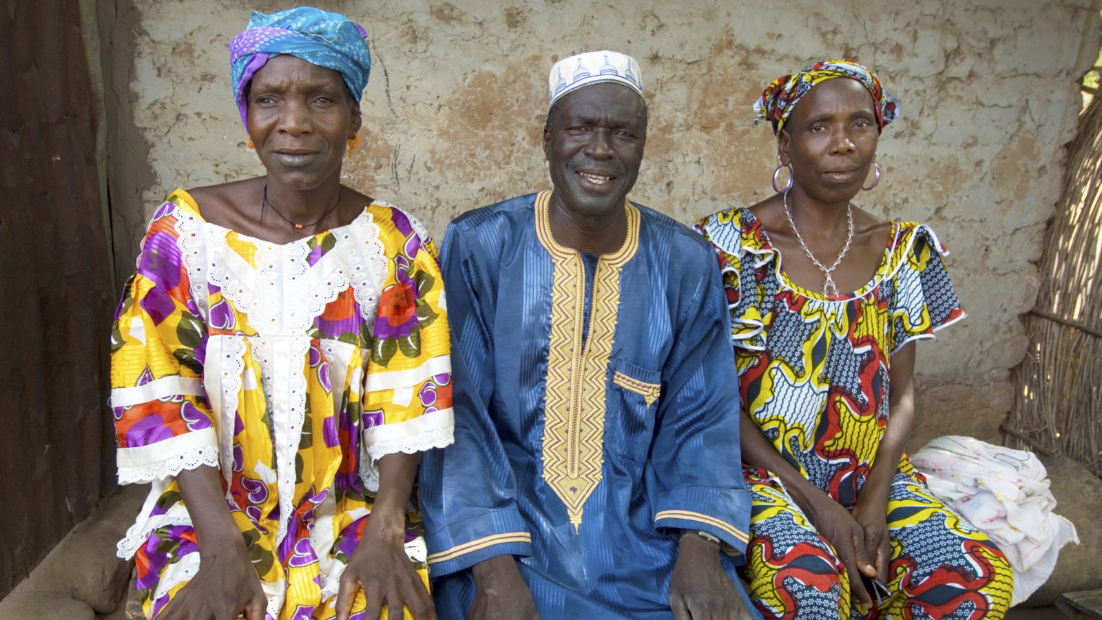 Juledh outside her home with her brother, Jadeh Ceesay and sister Mariam.
