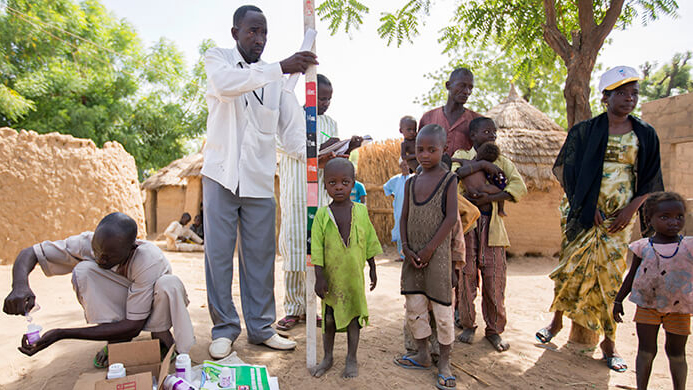 Children in northern Nigeria wait to receive medication as part of a mass drug distribution programme to treat NTDs.
