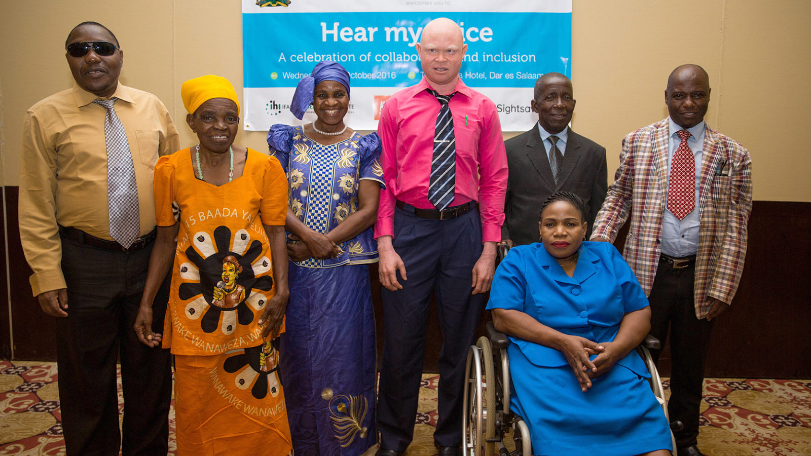 A group of peer researchers and speakers gather at the launch of the report on Voices of the Marginalised in Tanzania.
