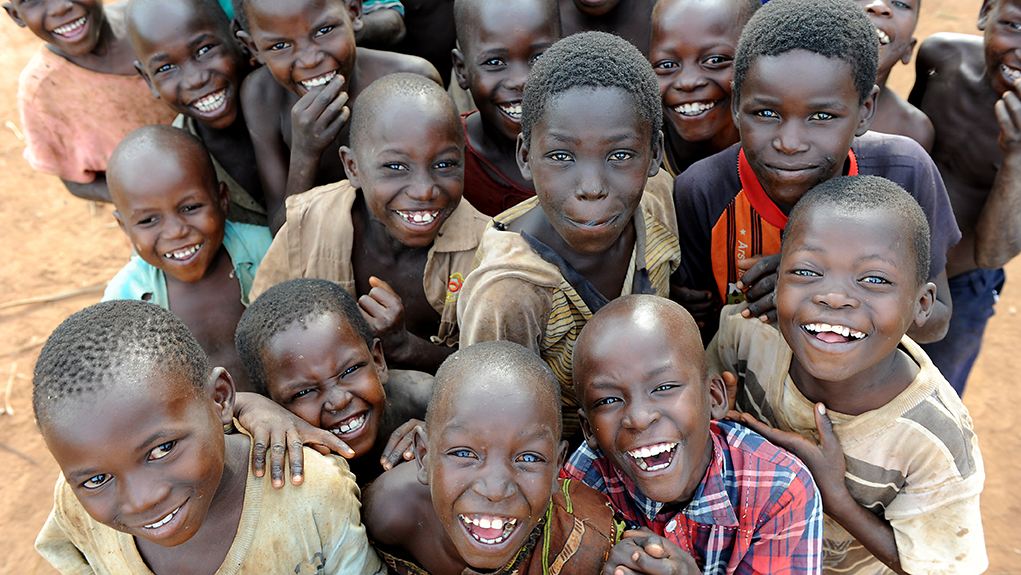 A group of smiling schoolboys in Kasuleta, a small rural village in Uganda.