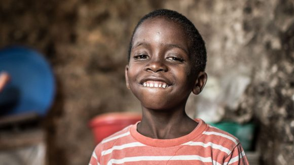 From the cover of Sightsavers' 2016 annual report: Fahad, aged 6, at his home in Zanzibar days after a successful operation to remove bilateral congenital cataracts.