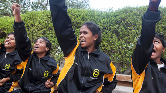 A group of blind and visually impaired women from Madhya Pradesh and Chhattisgarh districts in India practise their judo.