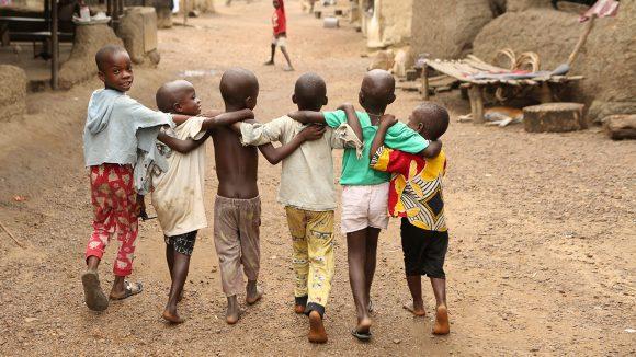 A group of smiling children in Foya, Sierra Leone.