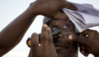 A man has his eyes checked for trachoma in Ghana.