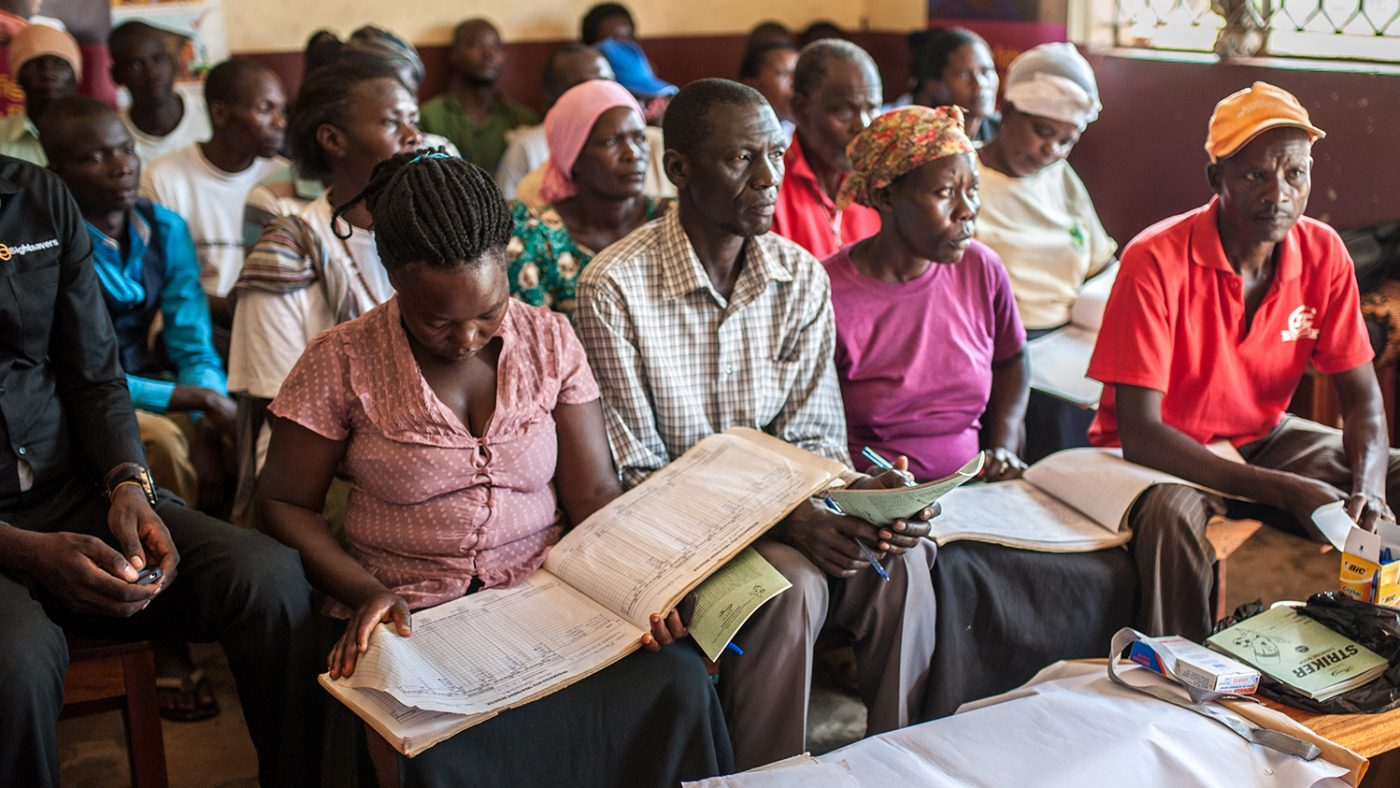 A group of Community Directed Distributors (CDD's) sit in a Volunteer Distributor Training course inside the Kibwoona Health centre in Masindi, Uganda where they are learning how to fill in the register.