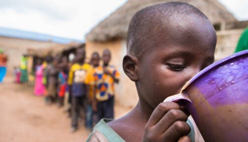 A small child receives his annual dose of medication to protect him from trachoma.
