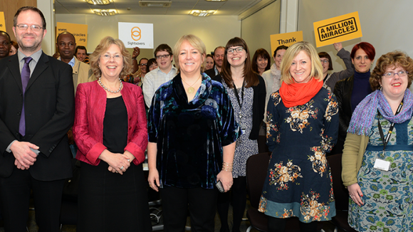 Sightsavers' staff smile for a photo together.