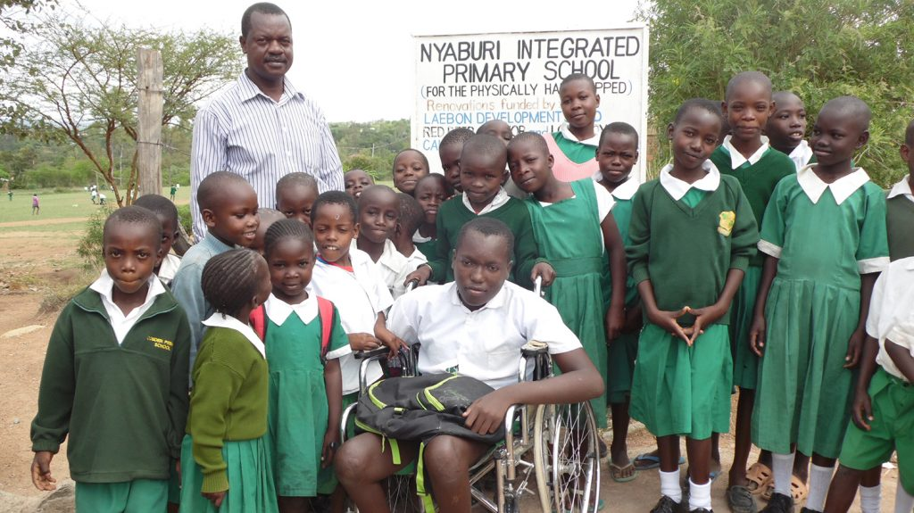 Flash with school friends in Kenya. Social Inclusion education equality.