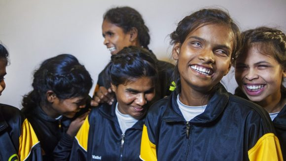 Group of blind girls in sportswear laughing and smiling