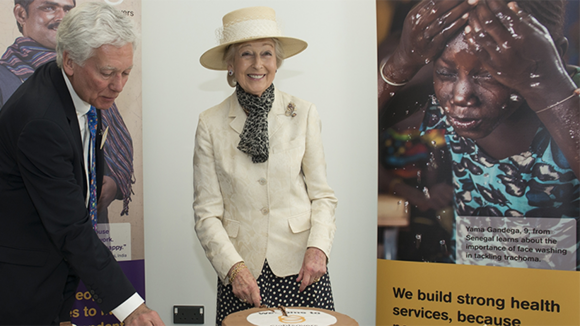 HRH Princess Alexandra smiles as she cuts a Sightsavers cake at head office in Haywards Heath.