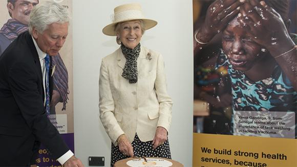 HRH Princess Alexandra smiles as she cuts a Sightsavers cake at head office in Haywards Heath.
