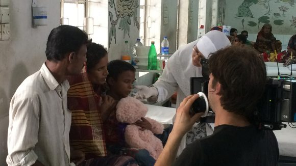 Majidul and his family being filmed by a camera crew in a hospital.