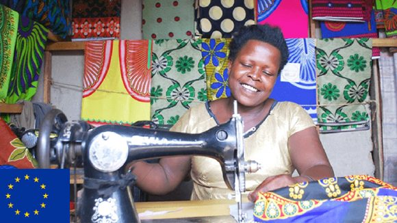 Rose sits at her sewing machine, a skill she learned during Sightsavers' Connecting the Dots programme in Uganda.