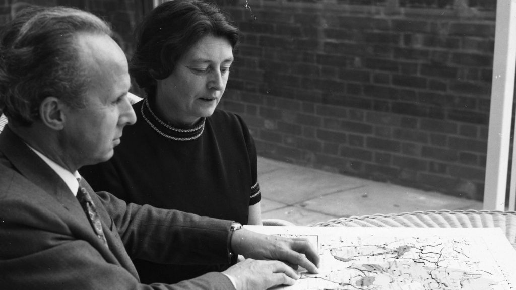 Sir John and Lady Wilson studying a braille map.