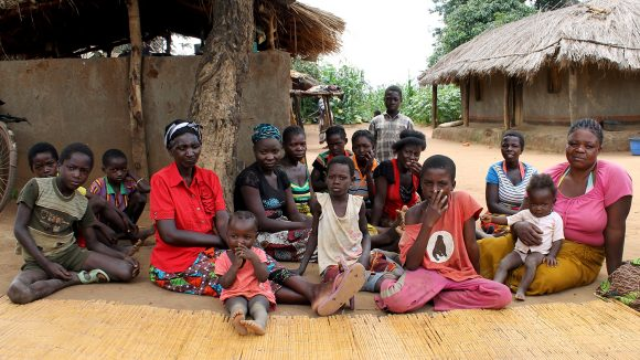 A group of villagers gathered outside their homes in Mwase village, Zambia.