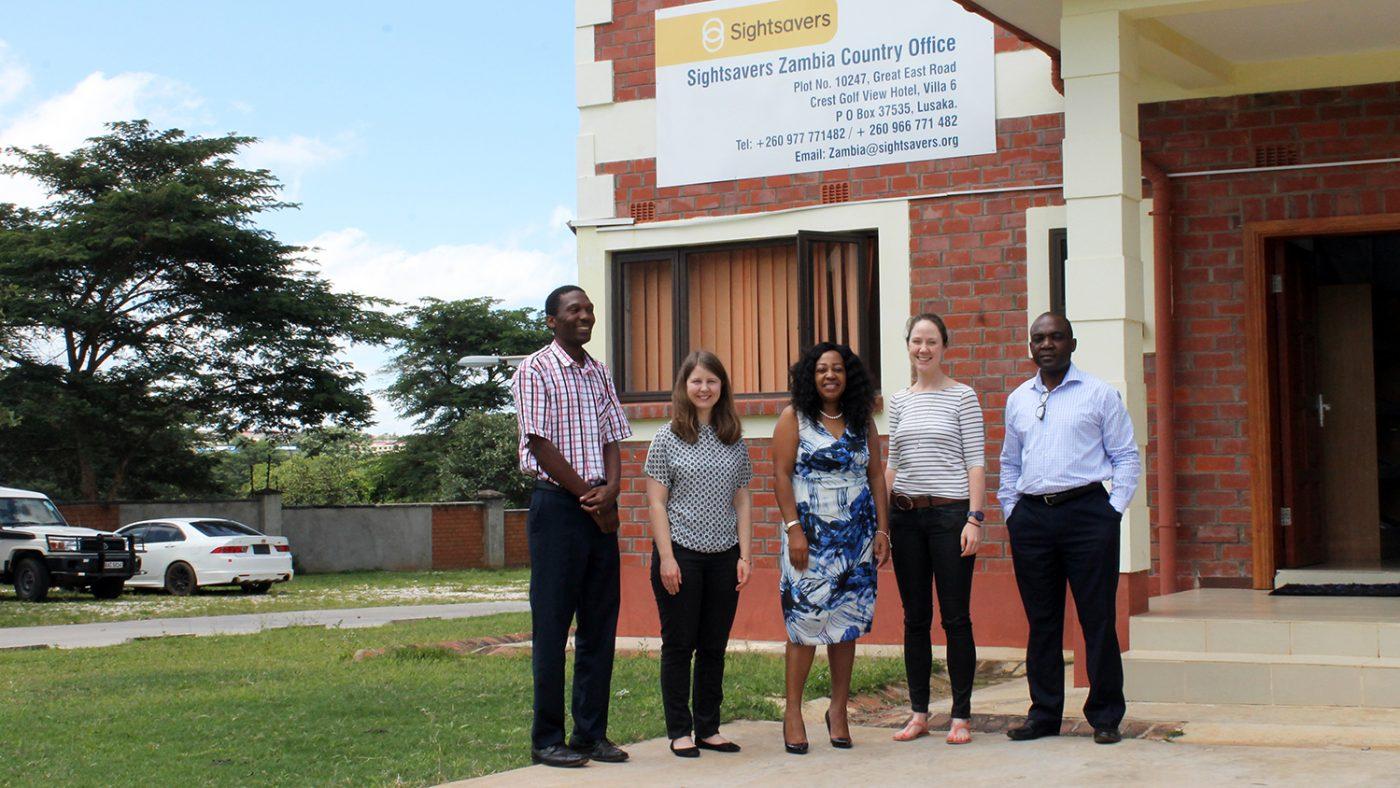 Moa Stenholm, Glenda Mulenga and Julia Strong with Sightsavers' Zambia staff outside the country office in Lusaka.
