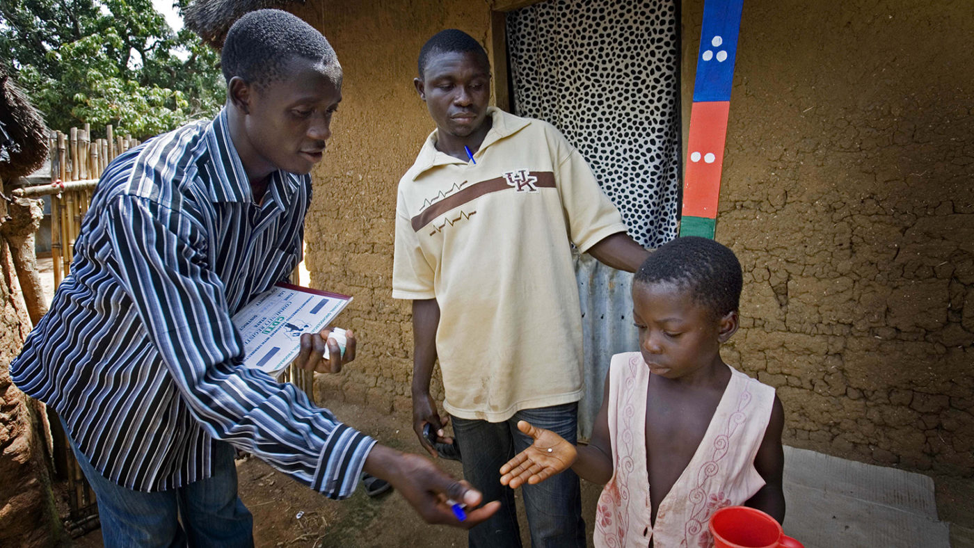 A drug distributor gives out medication to protect against river blindness and lymphatic filariasis.
