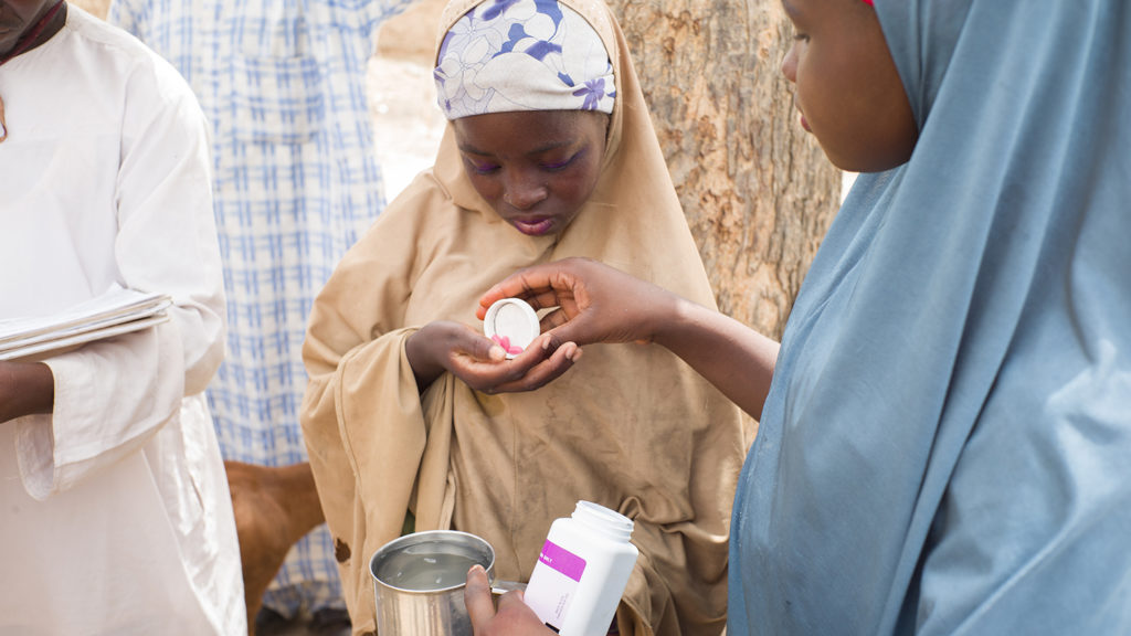 A girl in Kenya receives her medication to protect against river blindness and lymphatic filariasis.