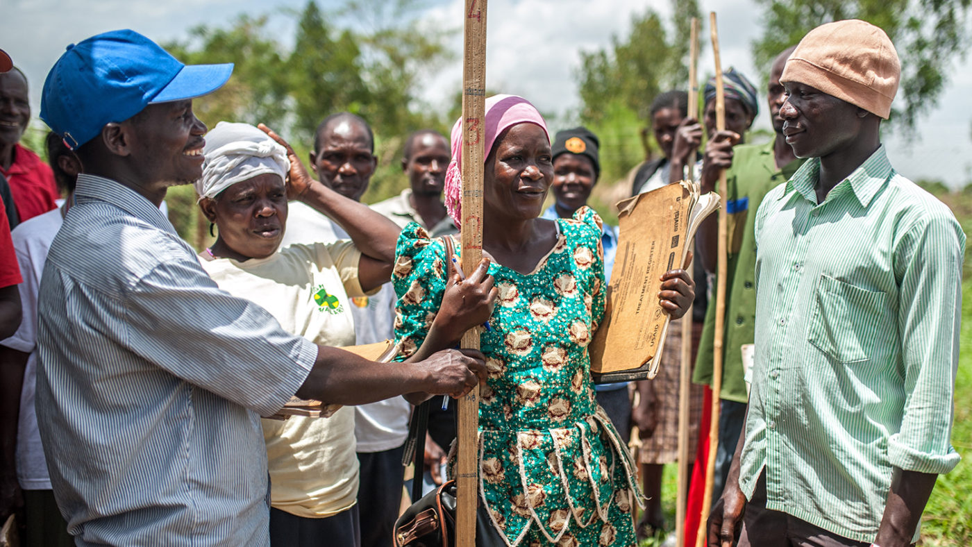 Students practice using measuring sticks to calculate drug dosages in Masindi, Uganda.