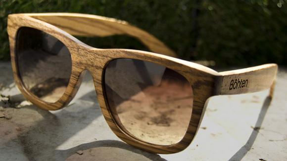 Pair of wood framed sunglasses.